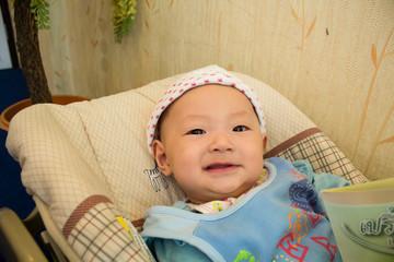 Cute baby in Bassinet