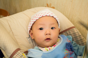 Cute baby in Bassinet