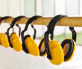 The yellow protective earmuffs for shooting .