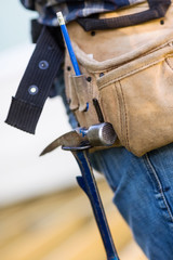 Hammer Hanging In Tool Belt Of Carpenter