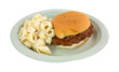 Pork barbecue sandwich and pasta on a paper plate