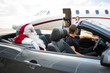 Santa And Chauffeur In Convertible While Airhostess Against Priv