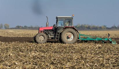 Tractor plowing on field