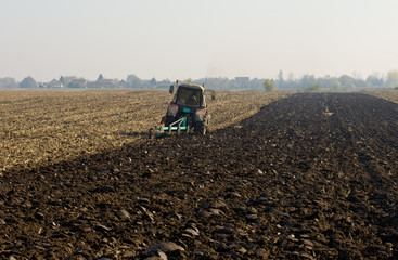 Tractor plowing on field
