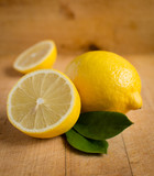 Fresh lemons on wooden table