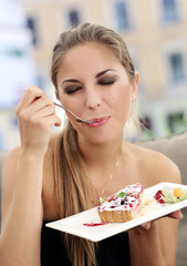 Woman is eating a pie