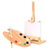 Photo of an artists easel with a blank canvas plus palette of pa