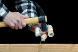 a handyman awkward trying to hammer a nail