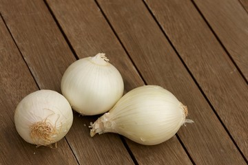 White onions on wooden table