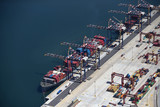 Aerial view of container ship moored at commercial dock