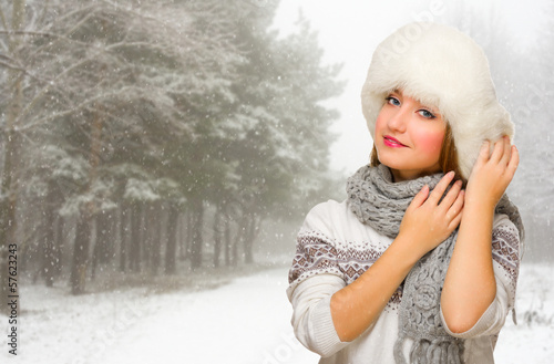 Young girl at winter forest