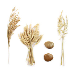 Grains and decorative stones, on white background