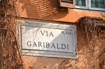 Street Plate in Trastevere District in Rome, Italy