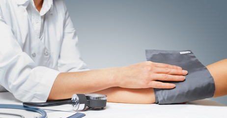 Sphygmomanometer on the patient's arm