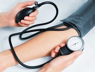 Blood pressure measuring on white background