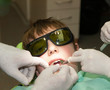 Boy with glasses in dental office