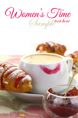 Cup of coffee with lipstick mark and croissant with jam