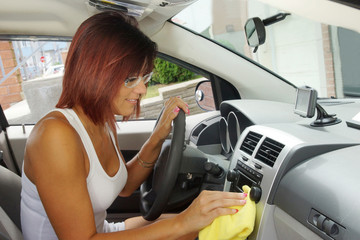 Woman cleaning the interior of her car