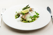 Sea bass fillet with asparagus infused with sauce foam