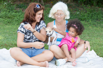 Latin Grandma, mother and daughter camping on a park