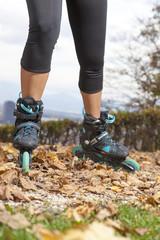 Feet of off road roller skater with in-line roller skates