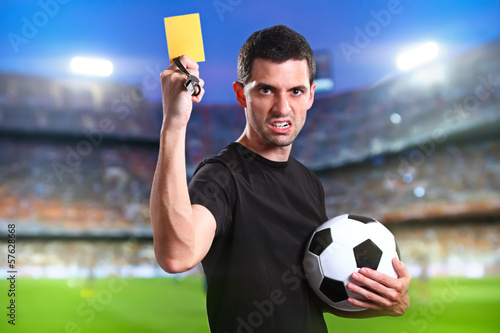 Referee with yellow card