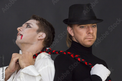 two vampires on a dark background