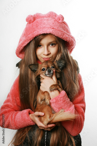Teenage girl holding chihuahua dog