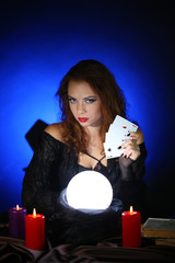 Halloween witch on dark blue background