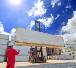 warehouse worker recording containers in shipping area