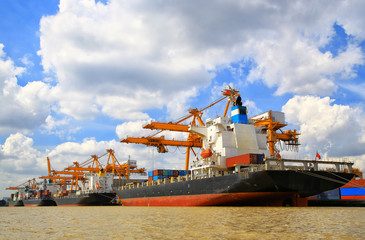 Cargo ship at the port  with blue sky