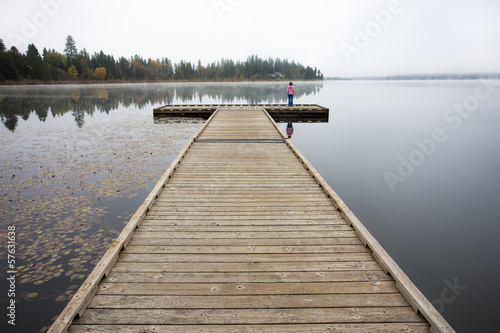 Child on end of the dock.