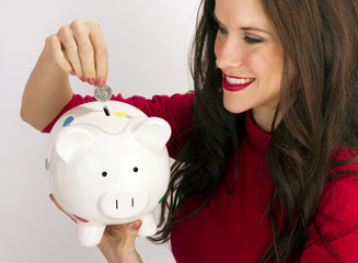 Pretty Happy Brunette Woman Drops Quarter Coin Savings Bank