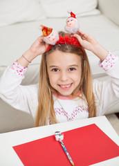 Happy Girl Holding Santa Headband
