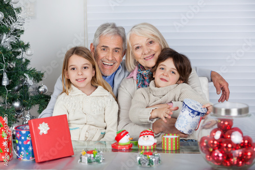 Children And Grandparents With Christmas Gifts