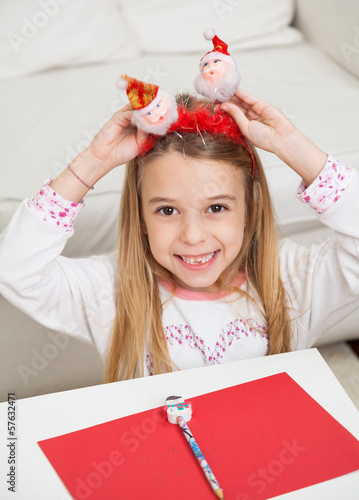 Happy Girl Holding Santa Headband