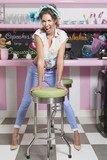 Portrait of retro woman in old-fashioned diner