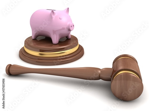 piggy bank and a wooden legal auction gavel on white