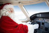 Santa Holding Control Wheel In Cockpit Of Private Jet