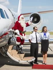 Santa Waving On Private Jet