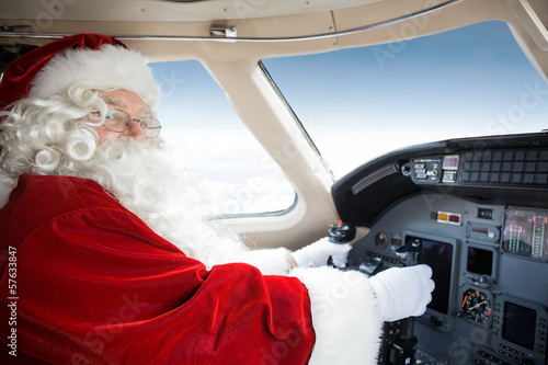 Santa Holding Control Wheel In Cockpit Of Private Jet - 57633847