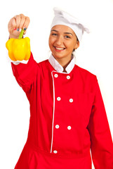 Chef woman giving pepper