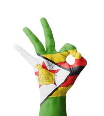 Hand making Ok sign, Zimbabwe flag painted