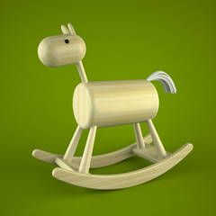 Wood rocking horse toy on green background
