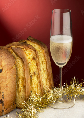 Panettone with champagne and Christmas decorations