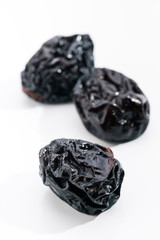 group of prunes on white base