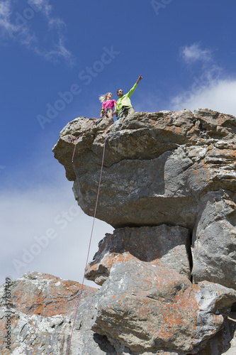 Rock climbers on top of rock