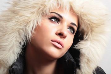beautiful woman in hood.white fur.winter style.fashion girl