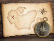 Adventure concept. Old compass on table with treasure map.