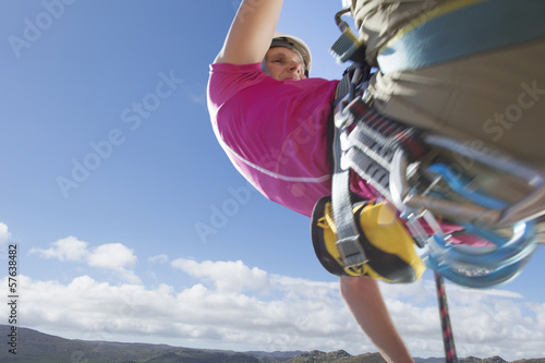 Close up of female rock climber abseiling